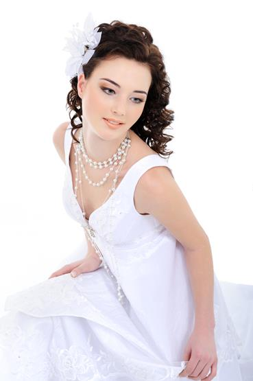Young beautiful elegant bride – white background